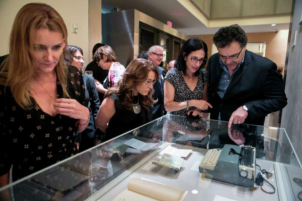 Rodrigo García Barcha, son of Gabriel García Márquez, examines a display with his wife, Adriana Sheinbaum. look at a selection of items from the Gabriel García Márquez archive at the Harry Ransom Center at the University of Texas at Austin. Ilana Panich-Linsman for The Houston Chronicle