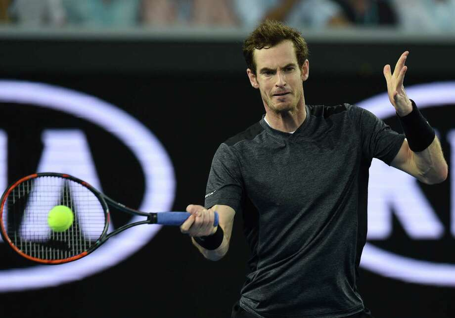 Britain's Andy Murray plays a forehand return during his men's singles match against Portugal's Joao Sousa on day six of the 2016 Australian Open tennis tournament in Melbourne on January 23, 2016. AFP PHOTO / GREG WOOD-- IMAGE RESTRICTED TO EDITORIAL USE - STRICTLY NO COMMERCIAL USEGREG WOOD/AFP/Getty Images Photo: GREG WOOD / AFP