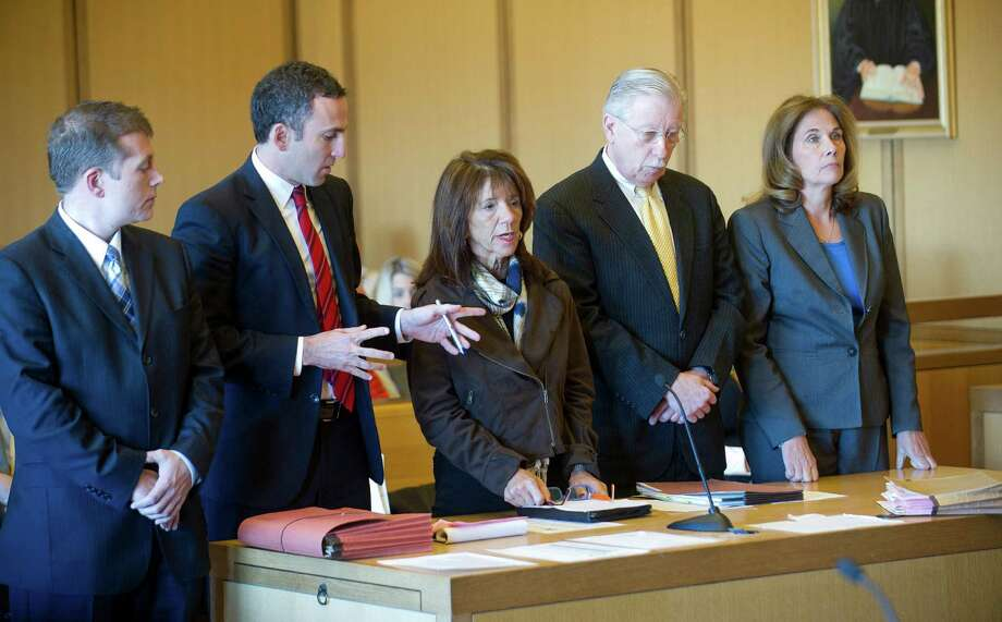 Stamford High School Principal Donna Valentine, left, and Assistant Principal Roth Nordin, right, appeared in court in November 2014 to answer charges they failed to report a teacher-student sexual relationship. With them are, from left, victim's attorney Devin Janosov, Valentine's attorney Mark Sherman, and Nordin's attorney Fred O'Brien. Photo: Hearst Connecticut Media File Photo / Stamford Advocate
