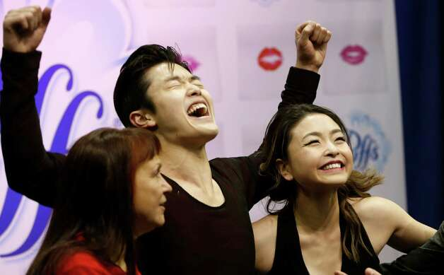 Maia Shibutani and Alex Shibutani celebrate after learning they won the dance championship of the U.S. Figure Skating Championships, Saturday, Jan. 23, 2016, in St. Paul, Minn. Woman at left is unidentified. (AP Photo/Jim Mone) Photo: Jim Mone, STF / AP