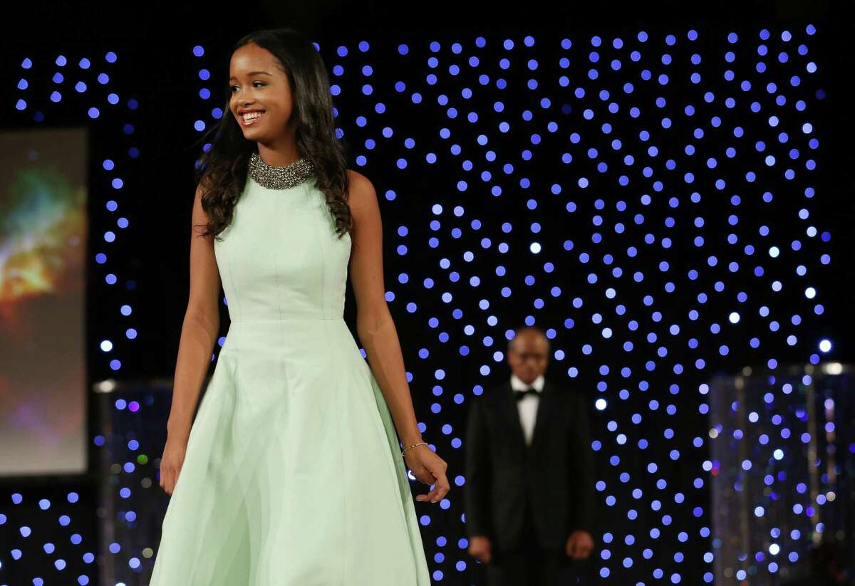 Bradlee Few on the runway at the Age of Aquarius Winter Ball