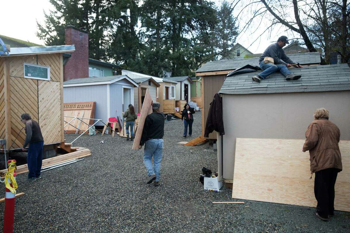 Volunteers rush to finish the Central District's new tiny house village on Friday, Jan. 22, 2016.