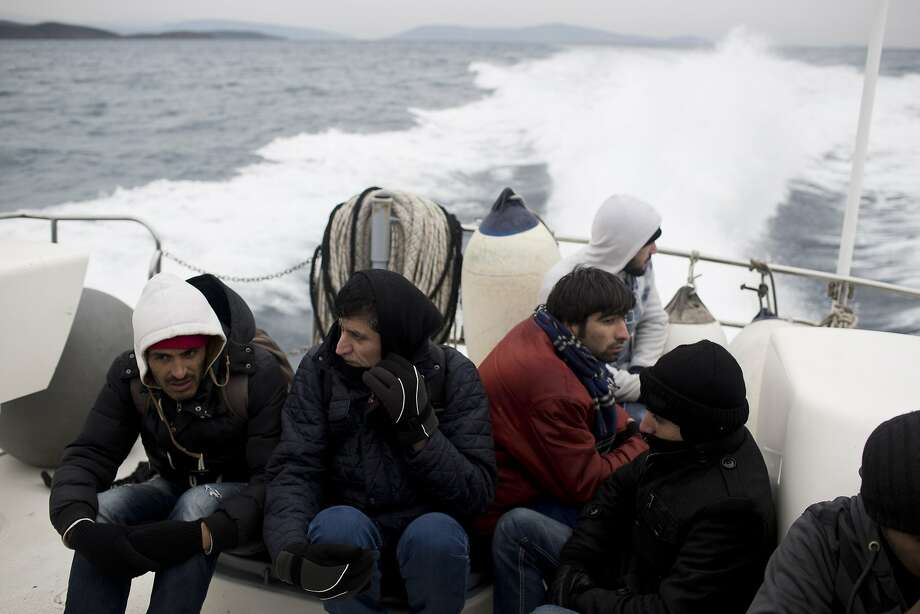 Syrian refugees sit on a Greek Coast Guard vessel during a rescue operation last week near the island of Chios. Already in 2016, more than 35,000 people have reached Greece by sea. Photo: Petros Giannakouris, Associated Press