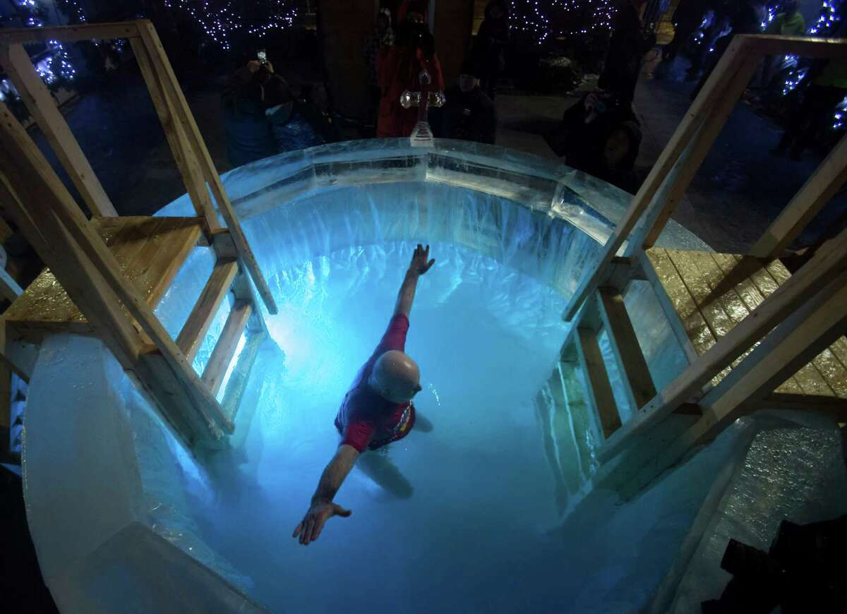 A Russian Orthodox believer bathes in a small ice pool to mark Epiphany in the center of Moscow, next to Red Square, Russia, Monday, Jan. 18, 2016. Water that is blessed by a cleric on Epiphany is considered holy and pure until next year's celebration, and is believed to have special powers of protection and healing. The Russian Orthodox Church follows the old Julian calendar, according to which Epiphany falls on Jan. 19.More photos: Wildest photos from 2016 epiphany celebrations around the world