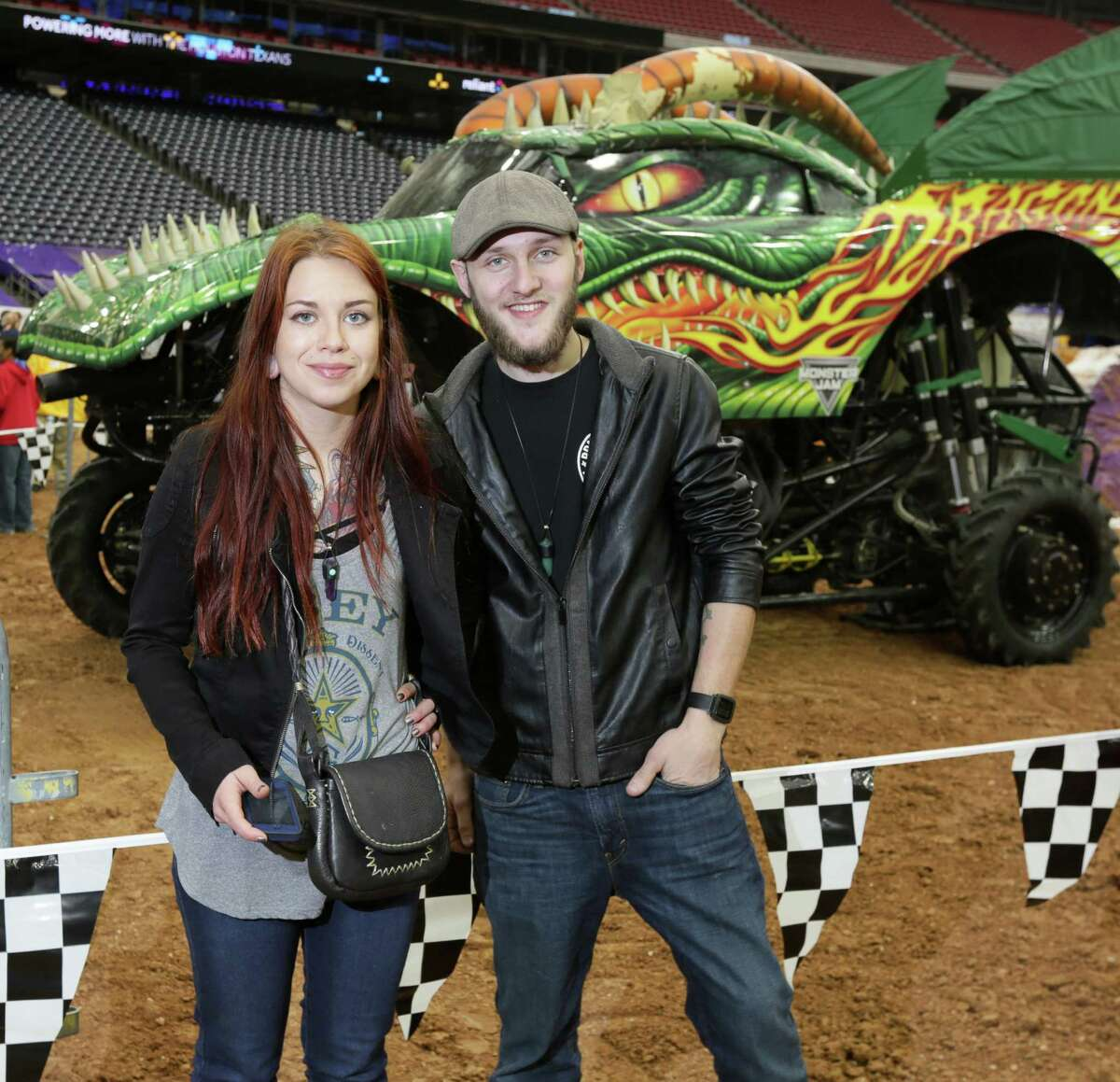 People pose for a photo at the Pit Party for Monster Jam at NRG Stadium Sunday, Jan. 24, 2016, in Houston.