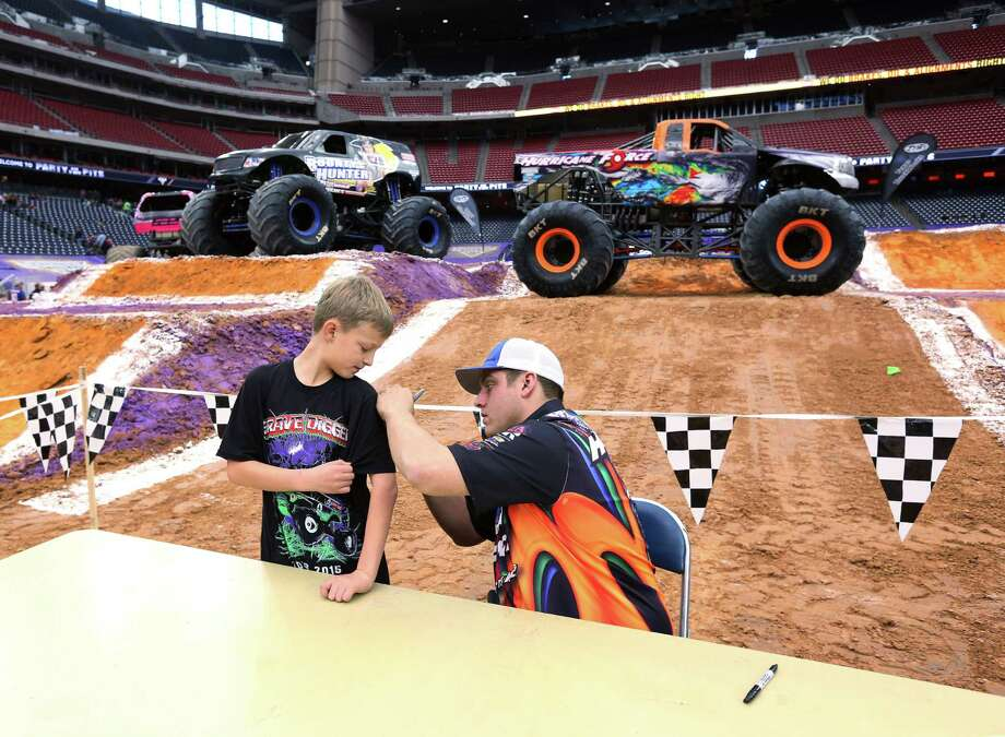 "Douglass Hil, 9, gets his shirt autographed by Steven Thompson, driver of the ""Hurricane Force"" monster truck at the Pit Party for Monster Jam at NRG Stadium Sunday, Jan. 24, 2016, in Houston. Photo: Jon Shapley, Houston Chronicle / © 2015  Houston Chronicle"