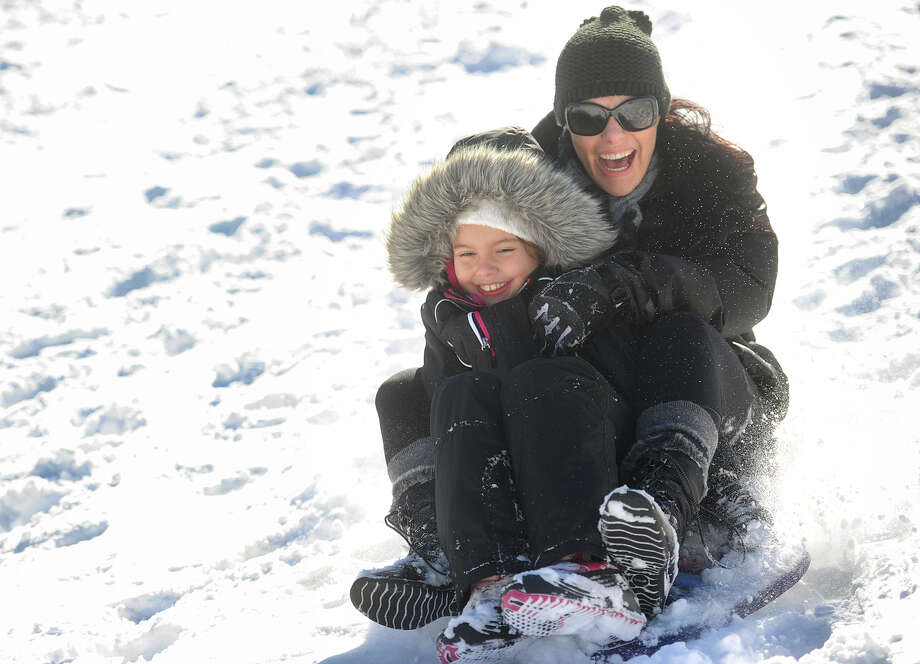 Academy HillStratford Julia, 8, and Priscilla Basseto, of Stratford, enjoy a morning of sledding at Academy Hill in Stratford, Conn. on Sunday, January 24, 2016. Photo: Brian A. Pounds, Hearst Connecticut Media / Connecticut Post
