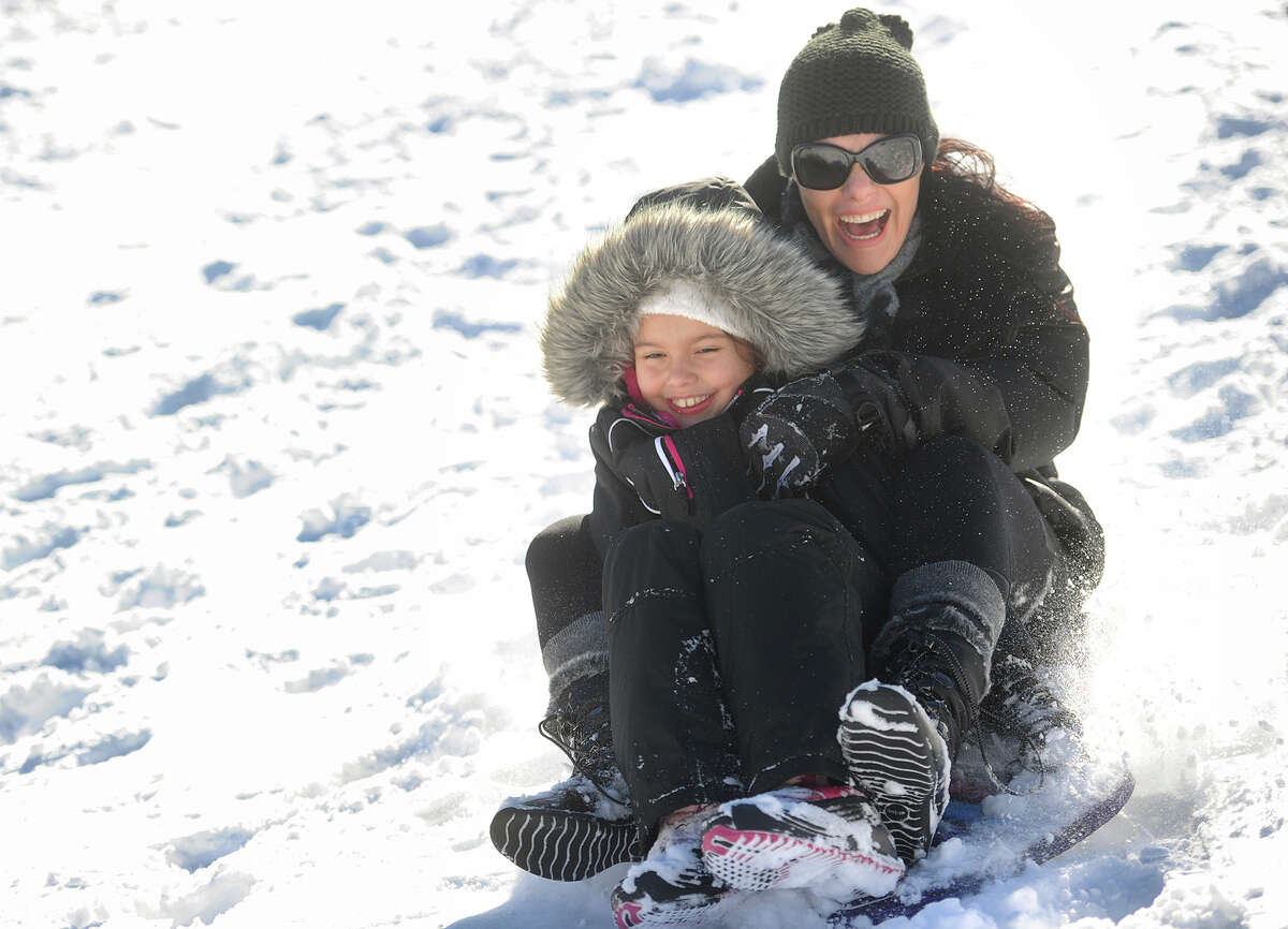 Academy Hill Stratford Julia, 8, and Priscilla Basseto, of Stratford, enjoy a morning of sledding at Academy Hill in Stratford, Conn. on Sunday, January 24, 2016.