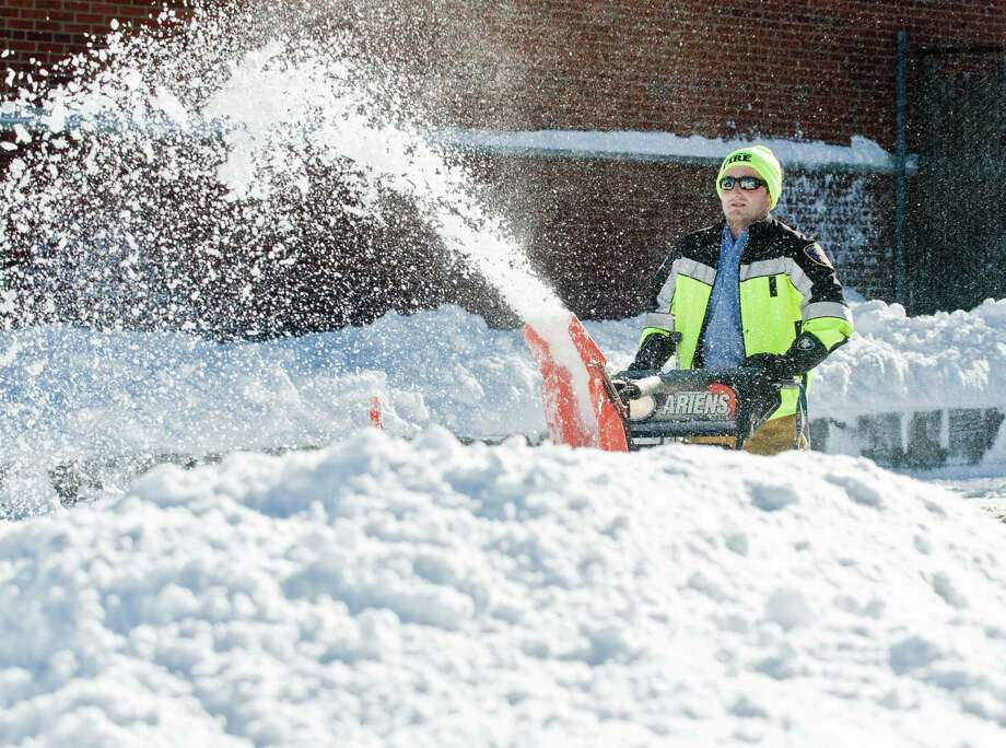 Ridgefield career firefighter Nick Paproski clears the fire department parking lot. Sunday, Jan. 24, 2016 Photo: Scott Mullin / For The / The News-Times Freelance