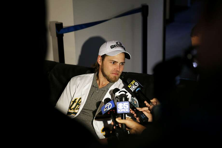 Josh Reddick, outfielder, talks to several reporters before A's Fanfest at the Coliseum in Oakland, California, on Sunday, Jan. 24, 2016. Photo: Connor Radnovich, The Chronicle