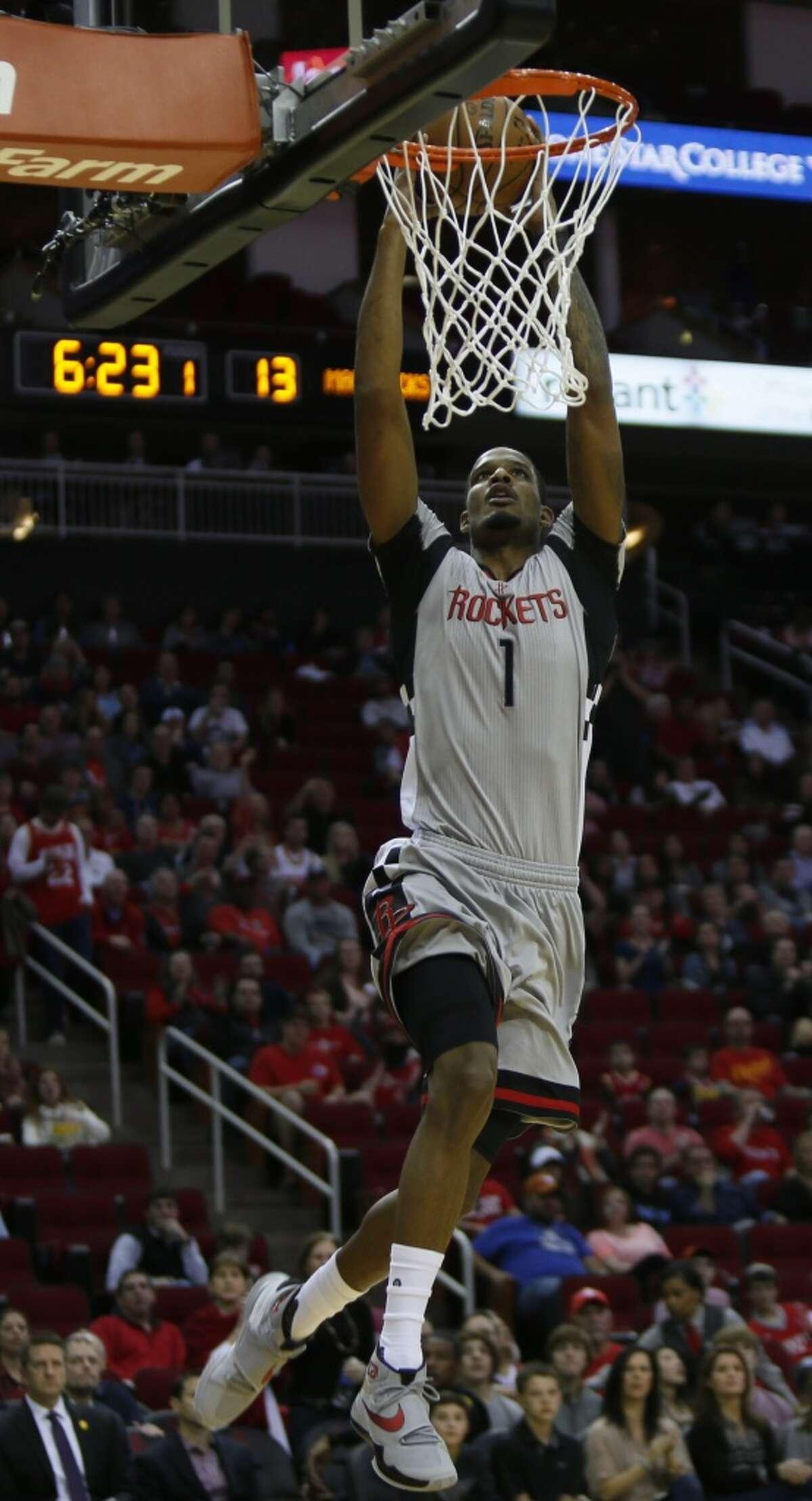 Houston Rockets forward Trevor Ariza (1) scores early in the game against the Dallas Mavericks, Sunday, Jan. 24, 2016, in Houston. ( Marie D. De Jesus / Houston Chronicle )