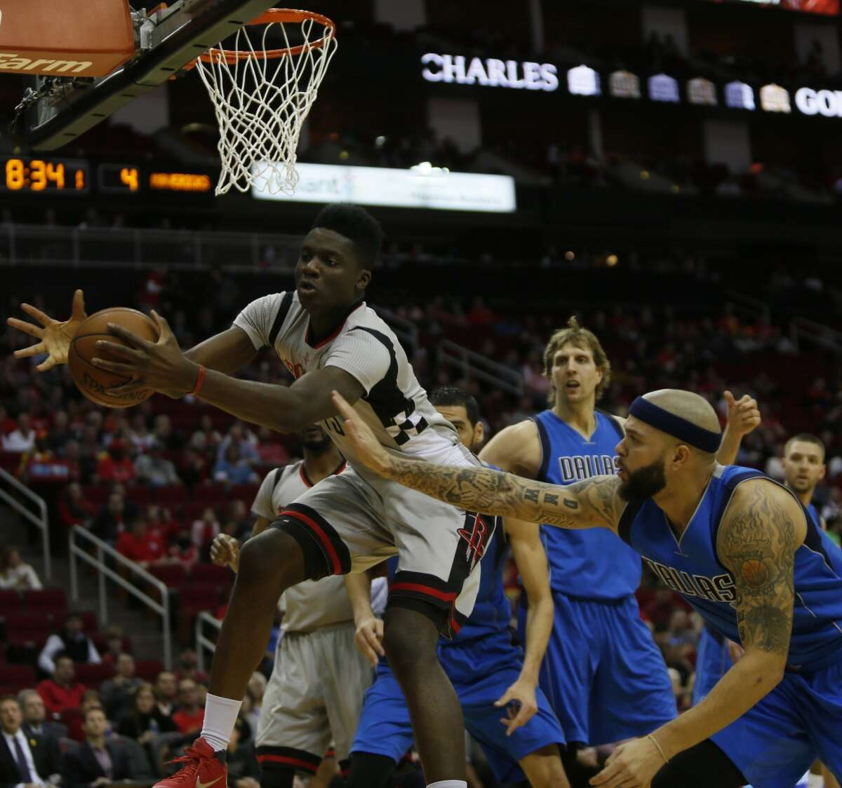 Houston Rockets forward Clint Capela (15) goes after a rebound under the pressure of Dallas Mavericks guard Deron Williams (8), Sunday, Jan. 24, 2016, at the Toyota Center in Houston. ( Marie D. De Jesus / Houston Chronicle )