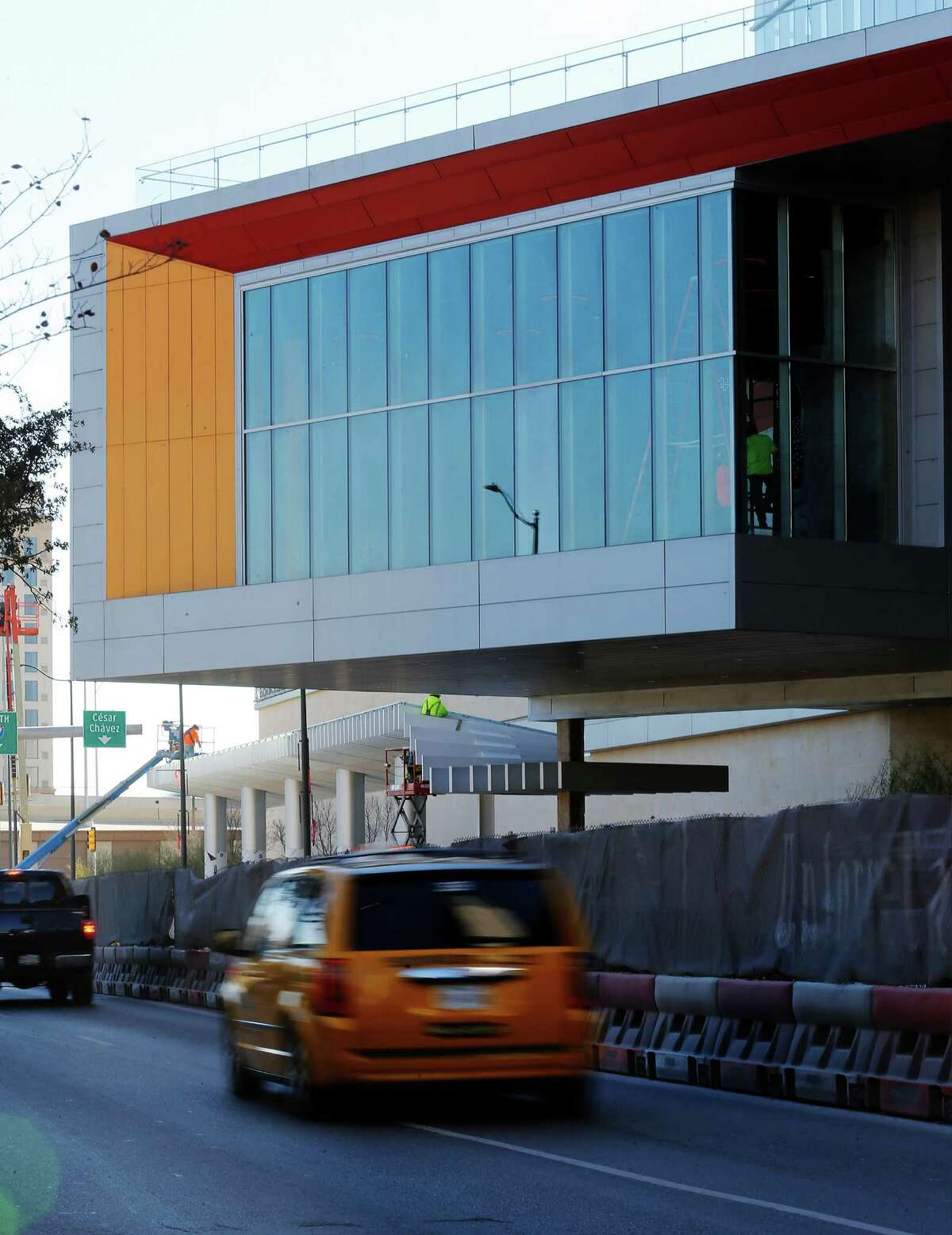 Traffic passes below the Cantilever Room. The Convention Center expansion will finally conclude construction and have convention business in the coming weeks. The project was the largest capital project in the city's history and features an innovative