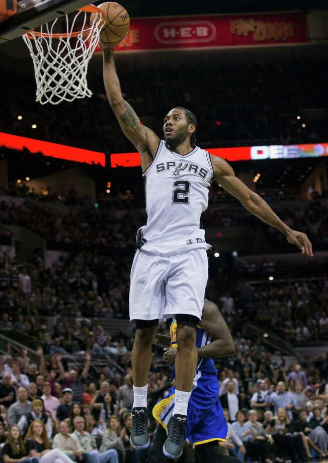 San Antonio Spurs forward Kawhi Leonard dunks during the second half of an NBA basketball game against the Golden State Warriors, Sunday, April 5, 2015, in San Antonio. San Antonio won 107-92. (AP Photo/Darren Abate) Photo: Darren Abate, FRE / Associated Press / FR115 AP