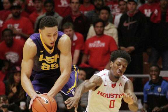 LSU Tigers forward Ben Simmons (25) struggles with Houston Cougars forward Danrad Knowles (0) for the ball  during the second half of a college basketball game at Hofheinz Pavillion Sunday, Dec. 13, 2015, in Houston. ( Jon Shapley / Houston Chronicle )