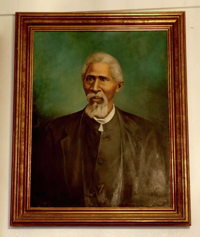 Rev. John Henry (Jack) Yates served as former first reverend of Antioch Missionary Baptist Church. Samuel A. Countee, grandson of Rev. Yates, painted the portrait. ( Gary Coronado / Houston Chronicle ) Photo: Gary Coronado, Staff / © 2015 Houston Chronicle