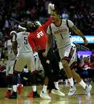 James Harden, left, shows his approval of Trevor Ariza's 29-point performance against the Mavs.
