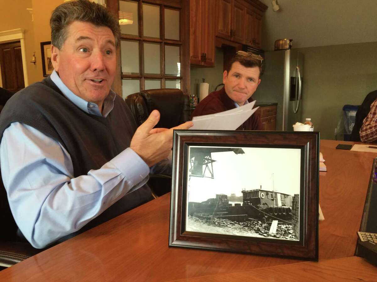 Port of Coeymans owner Carver Laraway talks about his interest in the history of Coeymans at the port office on Route 144 on Jan. 13, 2016. Port vice president of sales and business development Stephen Kelly, sits right. (Lauren Stanforth)