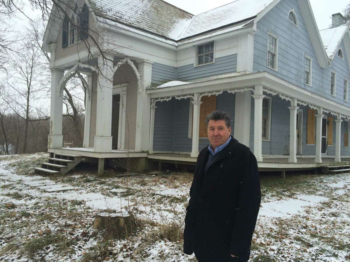 Port of Coeymans owner Carver Laraway seen outside a house at Church and Fifth streets in Coeymans on Jan. 13. 2016 that he purchased from a bank for $20,000. Laraway said it's part of his vision to help rehabilitate the withering historic hamlet. However, the house had since been demolished in 2019. (Lauren Stanforth)