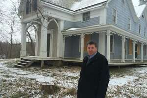 Port of Coeymans owner Carver Laraway outside a house at Church and Fifth streets in Coeymans on Jan. 13. 2016 that he purchased from a bank for $20,000. Laraway said it's part of his vision to help rehabilitate the withering historic hamlet. (Lauren Stanforth)