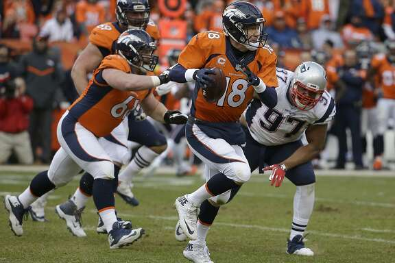 Denver Broncos quarterback Peyton Manning (18) scrambles during the second half of the NFL football AFC Championship game between the Denver Broncos and the New England Patriots, Sunday, Jan. 24, 2016, in Denver. (AP Photo/Chris Carlson)