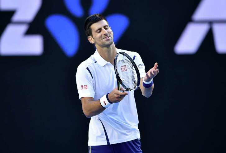 Novak Djokovic forces a smile during a match in which he committed 100 unforced errors.