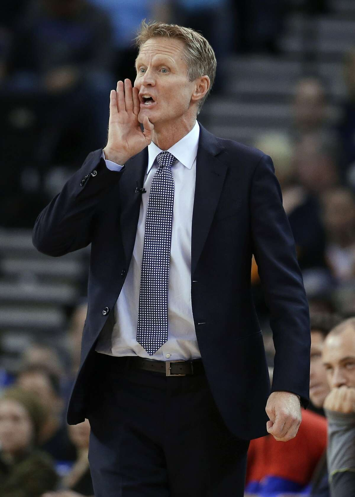 Golden State Warriors coach Steve Kerr shouts to his team during the first half of the Warriors' NBA basketball game against the Indiana Pacers on Friday, Jan. 22, 2016, in Oakland, Calif. (AP Photo/Marcio Jose Sanchez)