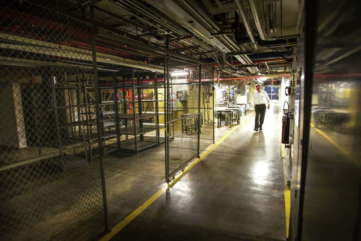 Peter Merwin, mixed use practice area leader, principal, Gensler, walks down a hallway as he takes a tour around the former Texas Instruments campus on Thursday, Jan. 21, 2016, in Stafford. Dallas-based developers, Street Level Investments, purchased the192-acre TI campus, are moving forward with plans to redevelop the site into a unique mixed-use development with shops, apartments, hotels and office space. ( Brett Coomer / Houston Chronicle )