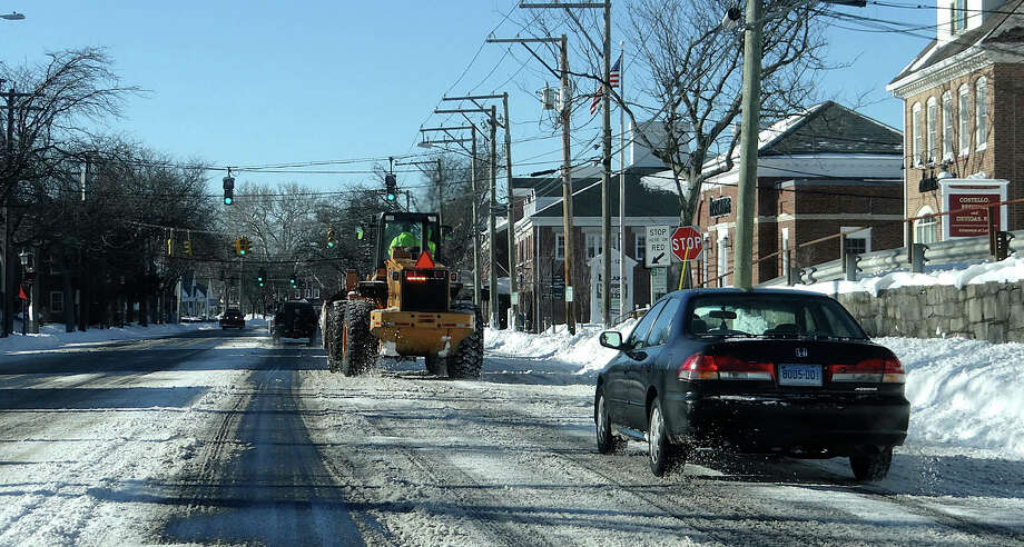 Storm cleanup operations overnight left the downtown stretch of the Post Road clear Sunday morning. Photo: Fairfield Citizen / Mike Lauterborn / Fairfield Citizen