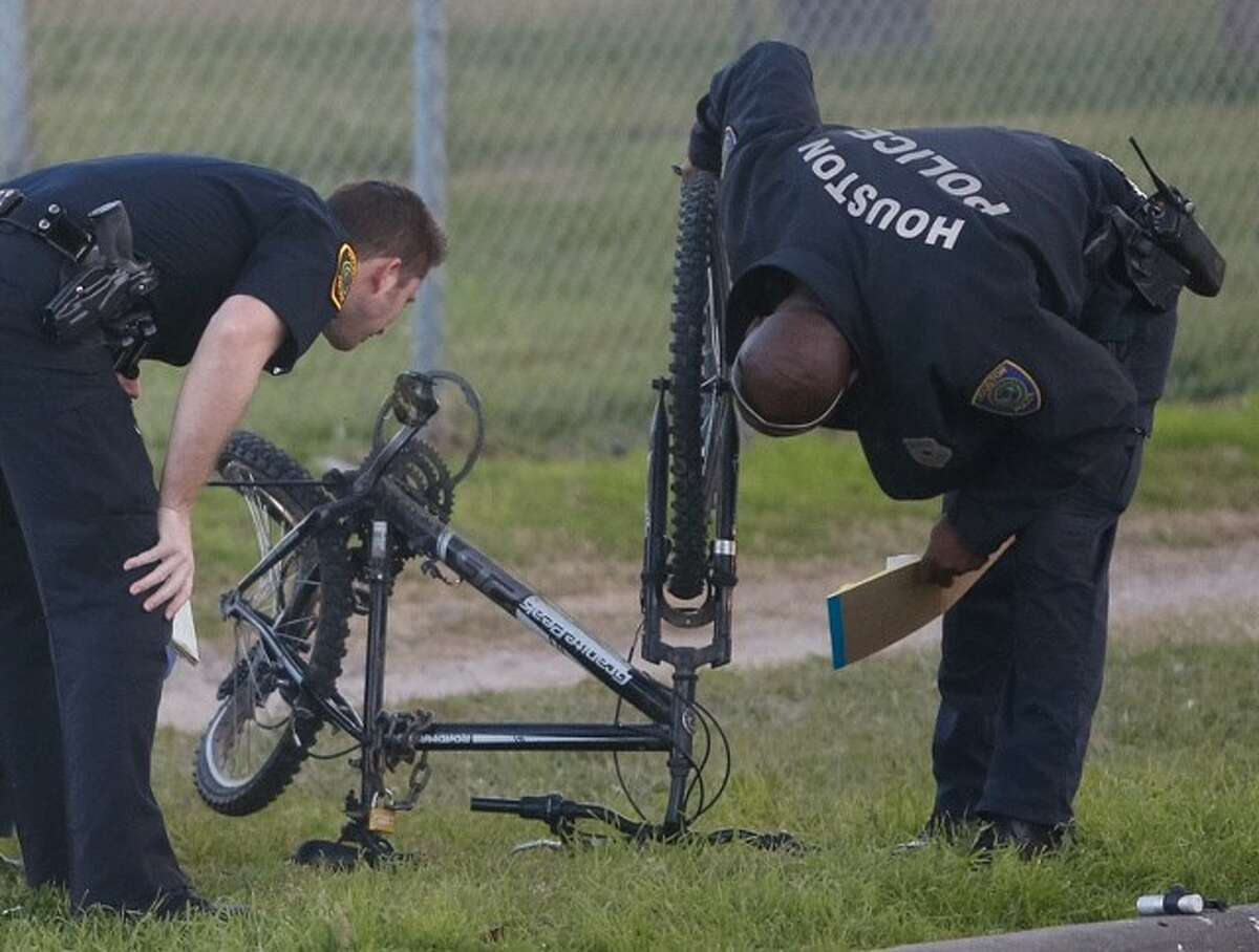 Houston Police inspect a damaged bicycle at the scene of an auto-pedestrian hit-and-run Jan. 25 in the 6200 block of Westpark Drive.  
