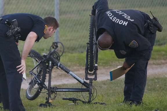 Houston Police inspect a damaged bicycle at the scene of an auto-pedestrian hit-and-run Monday morning, Jan. 25, 2016 in the 6200 block of Westpark Drive. |