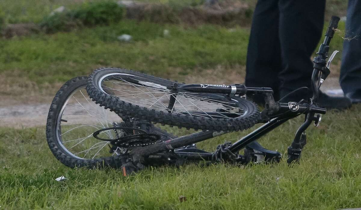 Houston Police inspect a damaged bicycle at the scene of an auto-pedestrian hit-and-run on Jan. 25 in the 6200 block of Westpark Drive.