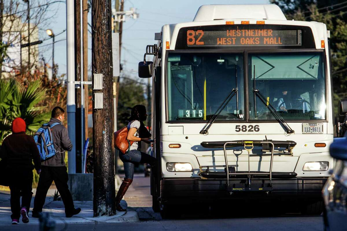People board the Route 82 Westheimer bus at the intersection of Westheimer Road and Shepherd on Jan. 22. The bus route is the city's most heavily-used.