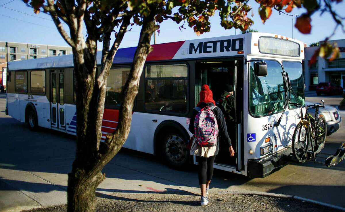 A woman boards the 82 Westheimer bus at the intersection of Westheimer Road and South Shepherd Drive on Jan. 22. The Westheimer route is Metro's busiest since bus system changes in August.
