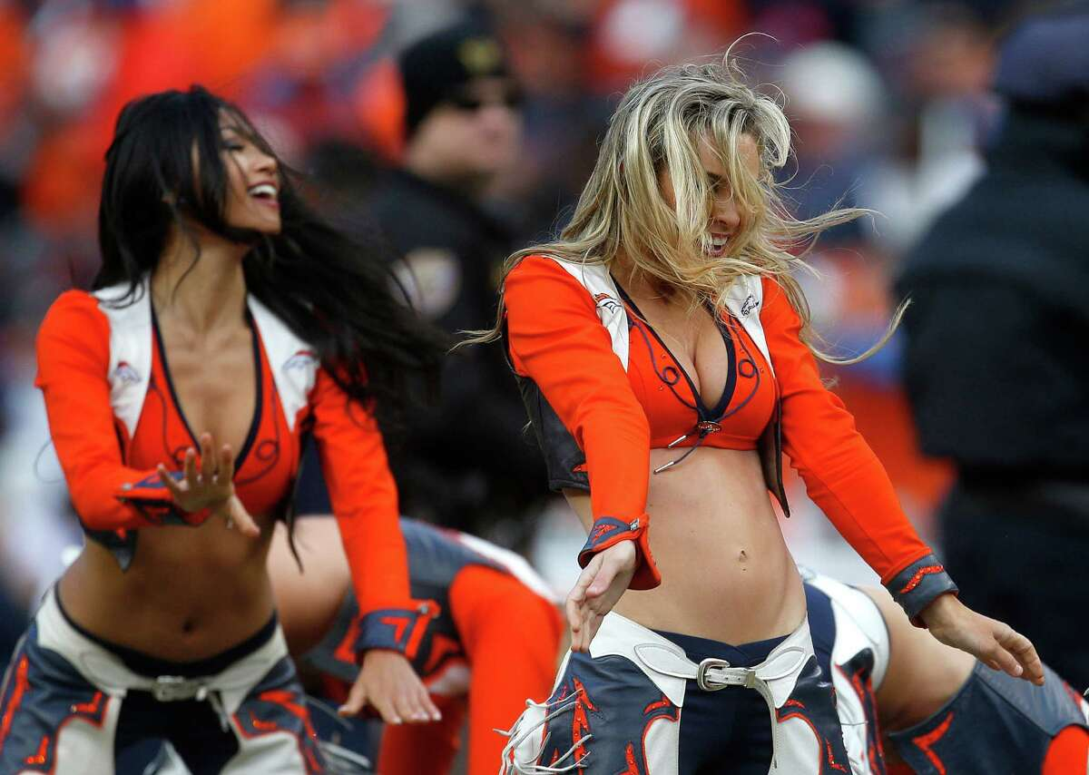 Denver Broncos cheerleaders perform during the first half of the NFL football AFC Championship game between the Denver Broncos and the New England Patriots, Sunday, Jan. 24, 2016, in Denver. (AP Photo/Joe Mahoney)