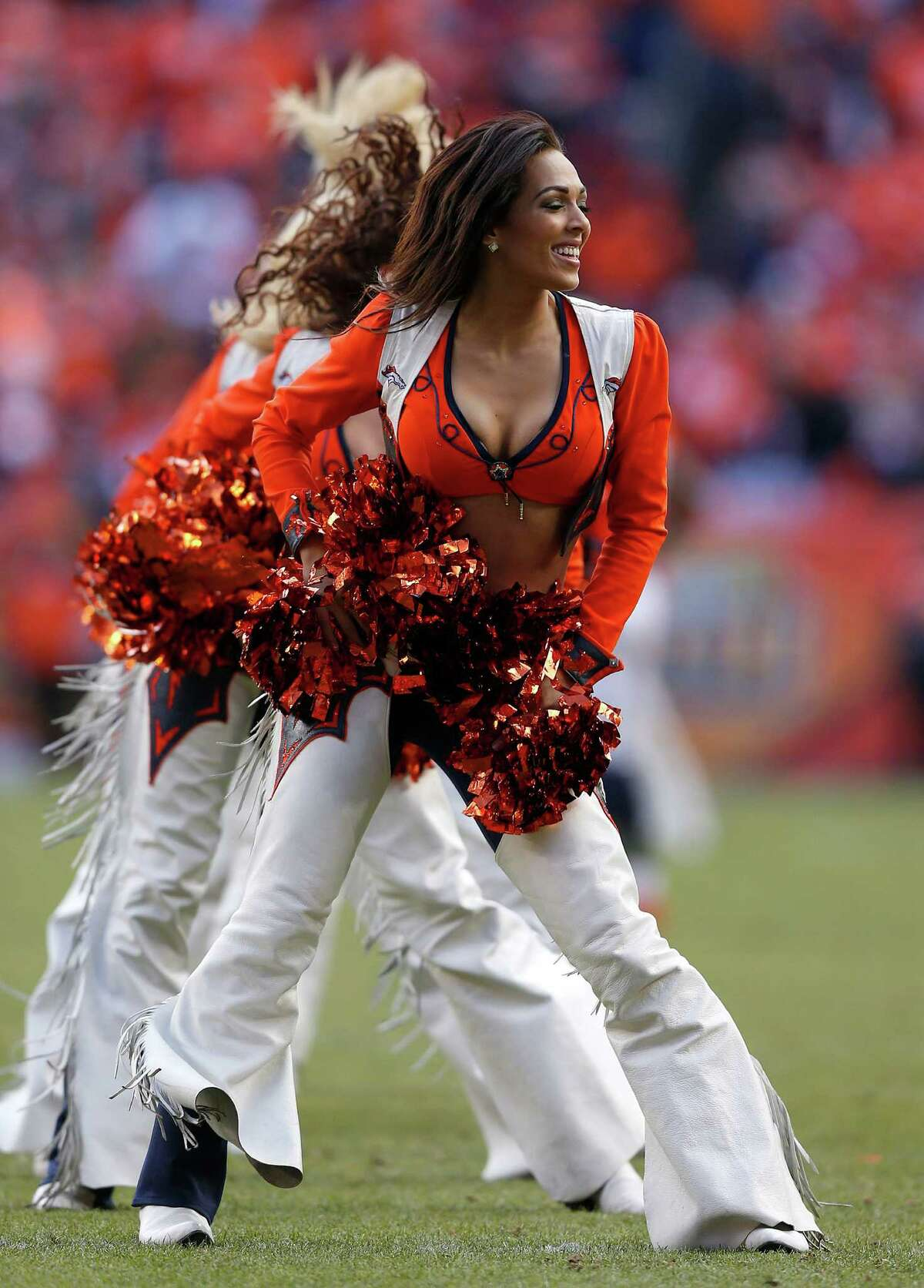 Denver Broncos cheerleaders perform during the first half of the NFL football AFC Championship game between the Denver Broncos and the New England Patriots, Sunday, Jan. 24, 2016, in Denver. (AP Photo/David Zalubowski)