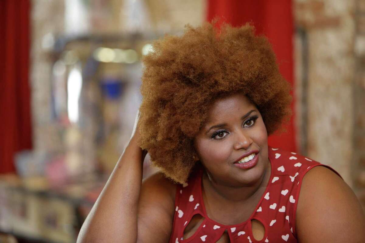 Kam Franklin, lead singer of The Suffers, talks during a break while filming a new music-based ad for the city, using a remix of their songGoodDay, shown Saturday, Jan.23, 2016, in Houston.