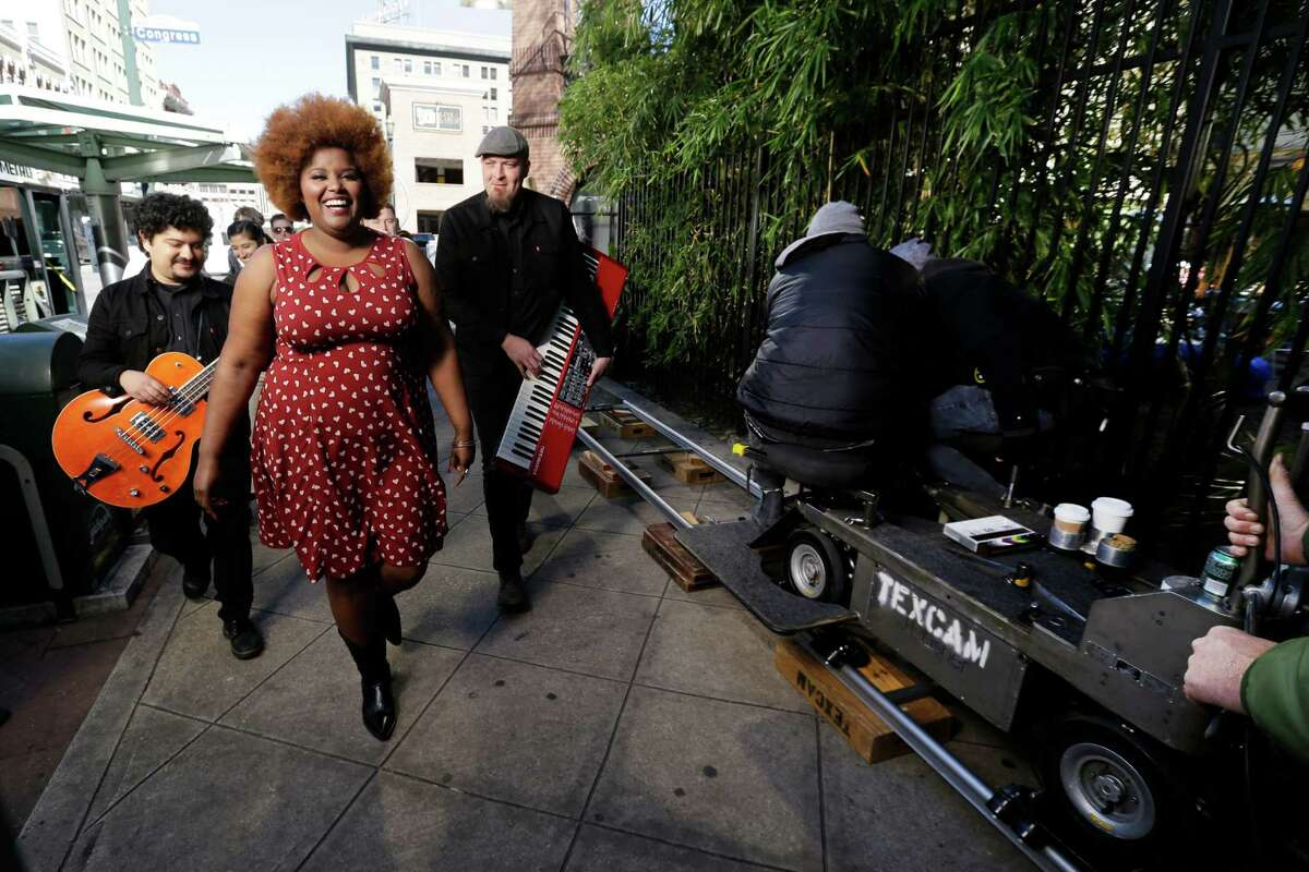 The Suffers with lead singer Kam Franklin is shown while filming a new music-based ad for the city, using a remix of their song Good Day, Saturday, Jan. 23, 2016, in Houston.
