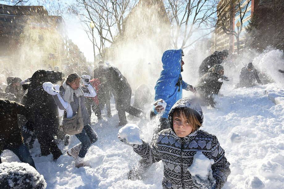 A 9-year-old gathers ammunition for a large snowball fight in Washington, D.C.'s Dupont Circle. Photo: The Washington Post, The Washington Post/Getty Images / 2016 The Washington Post