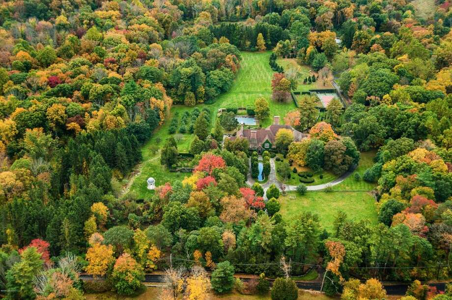 The property at 124 Old Mill Rd. in Greenwich, Conn. Thursday, Jan. 15,  2015.  The 15,862 sq. ft. house on 75.7 acres was formerly owned by  movie star Mel Gibson and went on the market for $31.5 million in January 2015. The current asking price is $25,750,000.  The mansion built in 1926 has 15 bedrooms, 10 full- and seven  half-baths, a pool, movie theater, tennis court, stables, pond, outdoor  hedge maze and life-sized outdoor chess board. Photo: Zillow