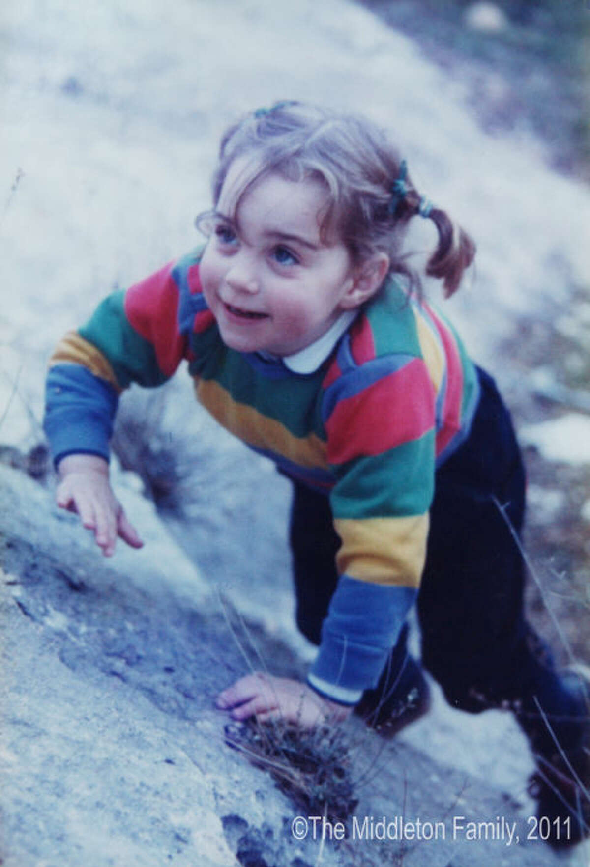 1985: A Happy Childhood On the go! Kate Middleton, 3, perfects her climbing while on a family holiday in the Lake District.