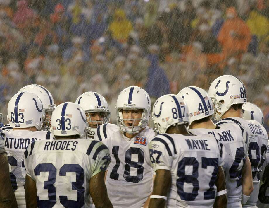 Indianapolis Colts quarterback Peyton Manning (18) directs his team in the huddle in the third quarter of the Super Bowl XLI football game against the Chicago Bears at Dolphin Stadium in Miami on Sunday, Feb. 4, 2007. (AP Photo/Alex Brandon) Photo: Alex Brandon, AP