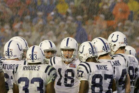 Indianapolis Colts quarterback Peyton Manning (18) directs his team in the huddle in the third quarter of the Super Bowl XLI football game against the Chicago Bears at Dolphin Stadium in Miami on Sunday, Feb. 4, 2007. (AP Photo/Alex Brandon)