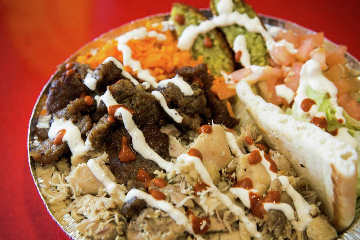 The Combo Plate, with extra falafel, is shown at The Halal Guys at 3821 Farnham on Monday, Jan. 25, 2016, in Houston. The franchise of a famous New York City eatery where people line up for gyros and chicken covered in a secret sauce.