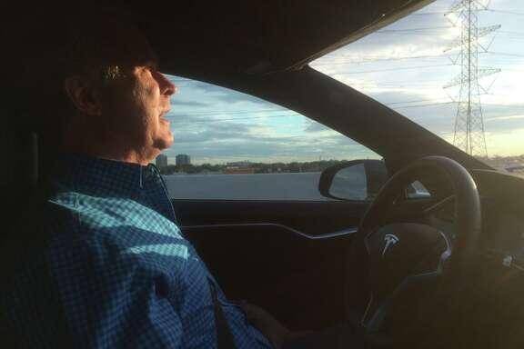 Steve Tennison's Tesla drives on autopilot down the Southwest Freeway.
