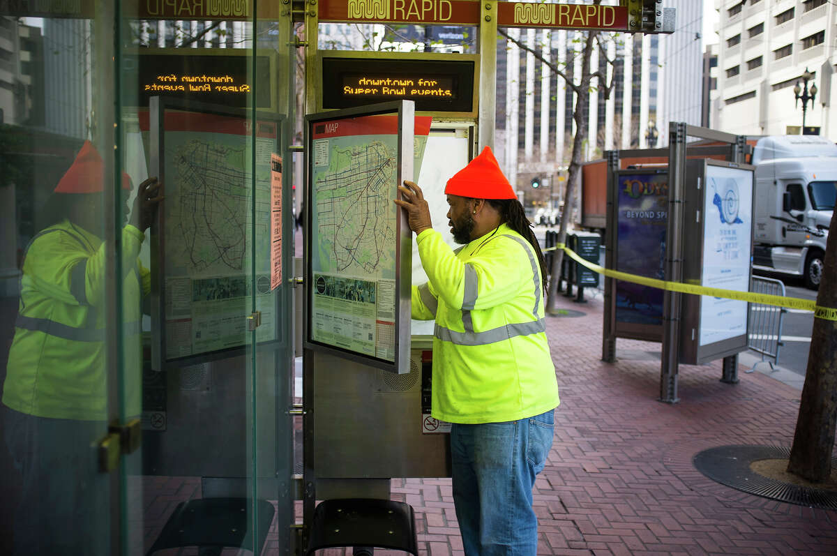 Randy Spears, of Richmond, replaces an SMTA map with an amended version as Preparations for Super Bowl 50's Super Bowl City in San Francisco have begun with a partial closure of Market street on Monday, Jan. 25, 2016.