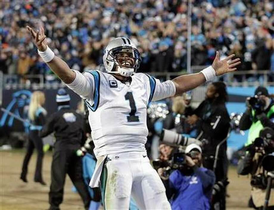 Cam Newton, quarterback de los Panthers de Carolina, celebra un touchdown durante la final de la Conferencia Nacional, frente a los Cardinals de Arizona (AP Foto/Chuck Burton) Photo: AP