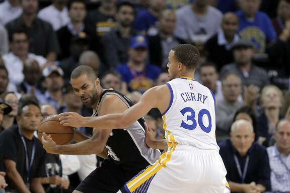 Stephen Curry (30) defends against Tony Parker (9) in the first half. The Golden State Warriors played the San Antonio Spurs at Oracle Arena in Oakland, Calif., on Tuesday, November 11, 2014.