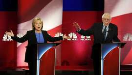 Democratic presidential candidates, former Secretary of State Hillary Clinton, left, and Sen. Bernie Sanders, I-Vt. talk over each other during the Democratic presidential primary debate at the Gaillard Center, Sunday, Jan. 17, 2016, in Charleston, S.C. (AP Photo/Mic Smith)
