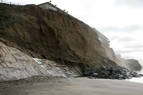 The eroding cliff behind apartments at 310 Esplande Ave. in Pacifica, California, on Monday, Jan. 25, 2016.